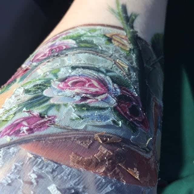 At this stage of healing during Week 2,  it is normal for tattoos to scab and peel.